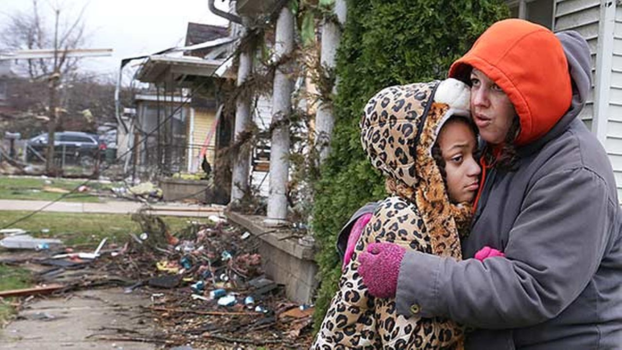 Valerie McAvoy hugs her daughter Olivia after their home on 19th Street in Naplate was destroyed by a tornado Tuesday evening. Around 50 homes had damage in the town of Naplate. Scott Anderson, LaSalle Newstribune