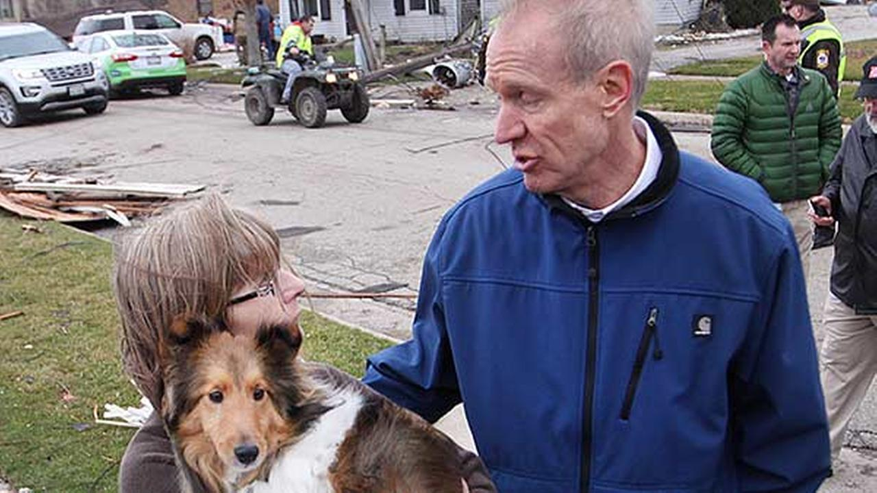 Illinois Governor Bruce Rauner, comforts Julie Wielgopola and her dog Kirby while touring the town Wednesday morning.Scott Anderson, LaSalle Newstribune