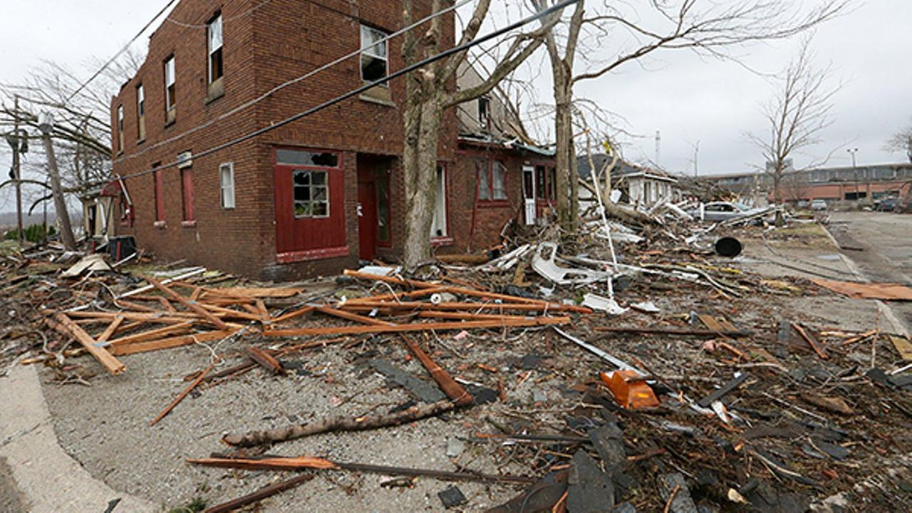 A home at 302 19th avenue is covered with debris from the tornado that tore through Naplate on Tuesday night. Scott Anderson, LaSalle Newstribune