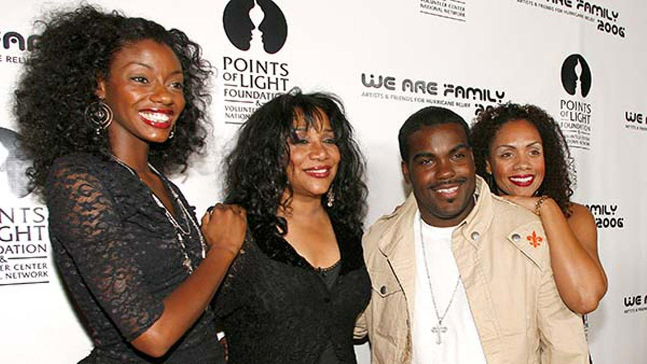 This Aug. 14, 2006 file photo shows Joni Sledge, one of the original members of Sister Sledge, second from left, posing with Rodney Jerkins, her niece and her cousin.