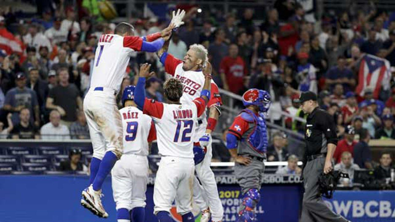 Puerto Ricos Yadier Molina, second from right, reacts with teammates after hitting a home run during the sixth inning of a second-round World Baseball Classic game against the Dominican Republic.