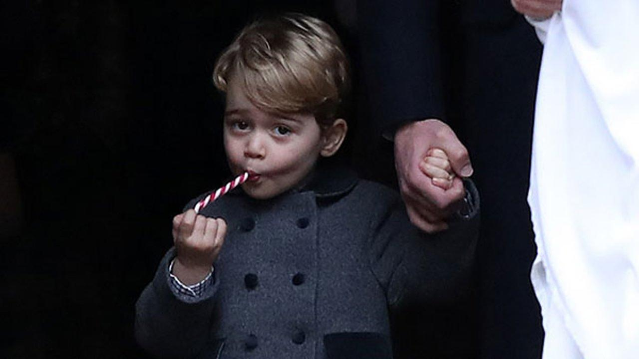 Prince George eats a sweet as he leaves following the morning Christmas Day service at St Marks Church in Englefield, England, on Sunday Dec. 25, 2016.