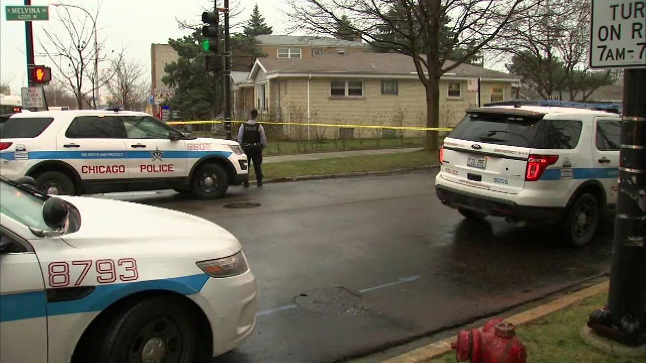Chicago police investigate a shooting in the Belmont Cragin neighborhood Monday.