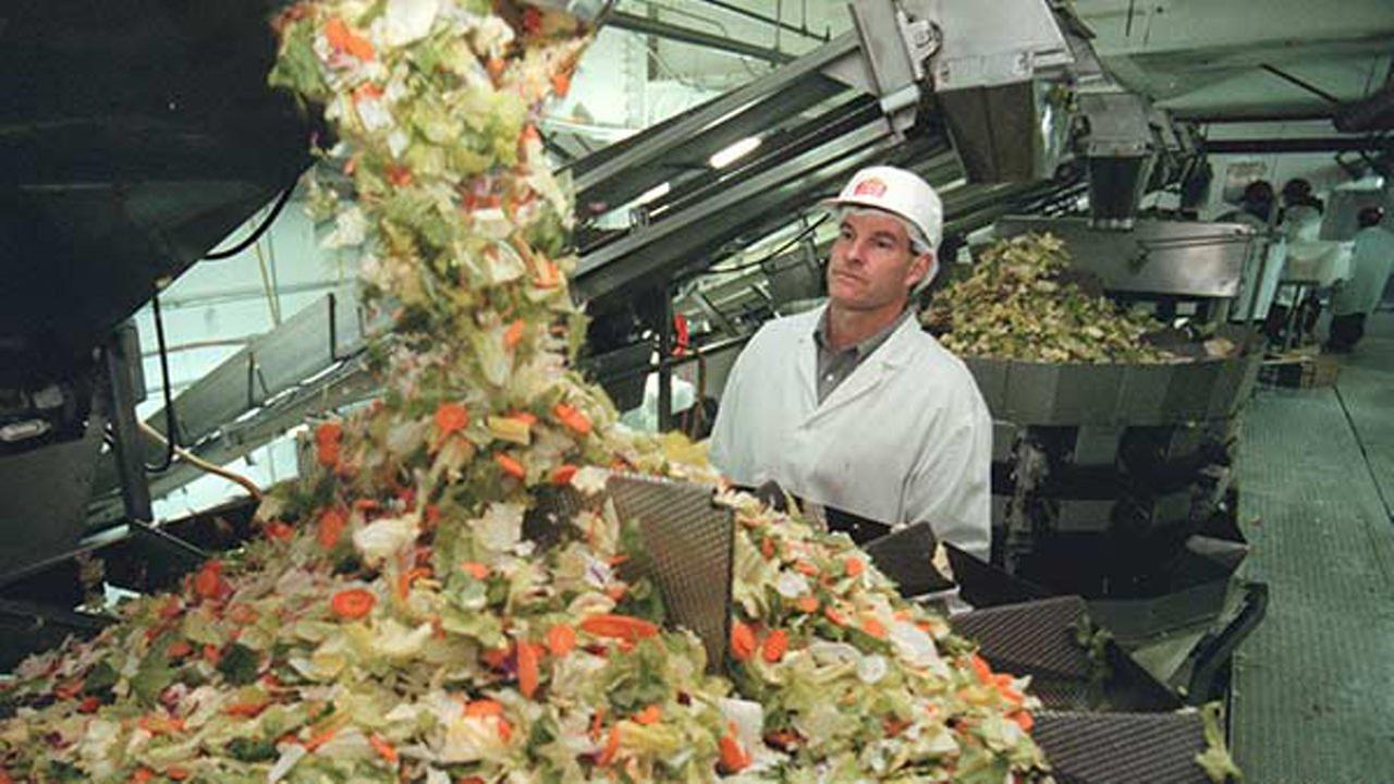 Fresh Express CEO Steve Taylor looks over a salad packaging machine at the Fresh Express packaging plant in Salinas, Calif., Monday, Jan. 31, 1999.