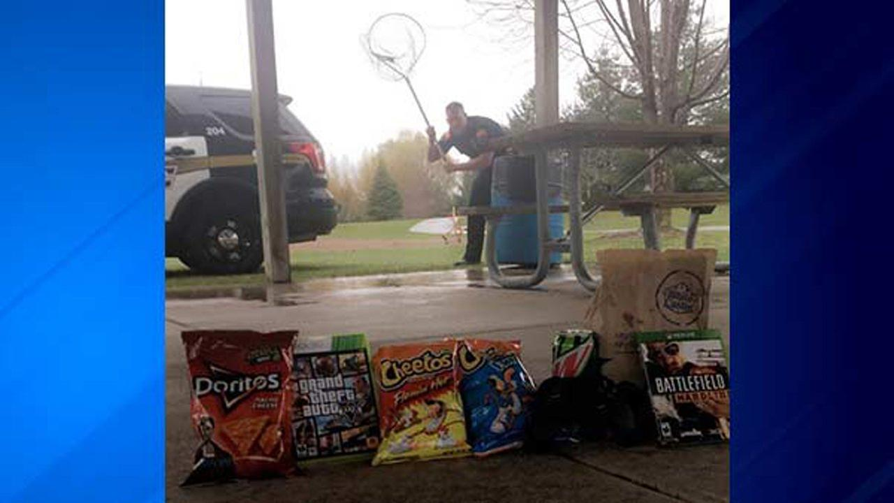 The Wyoming Police Department tweeted a staged picture showing a trap baited with munchies and video games - along with an officer ready to net any stoners who take the bait!