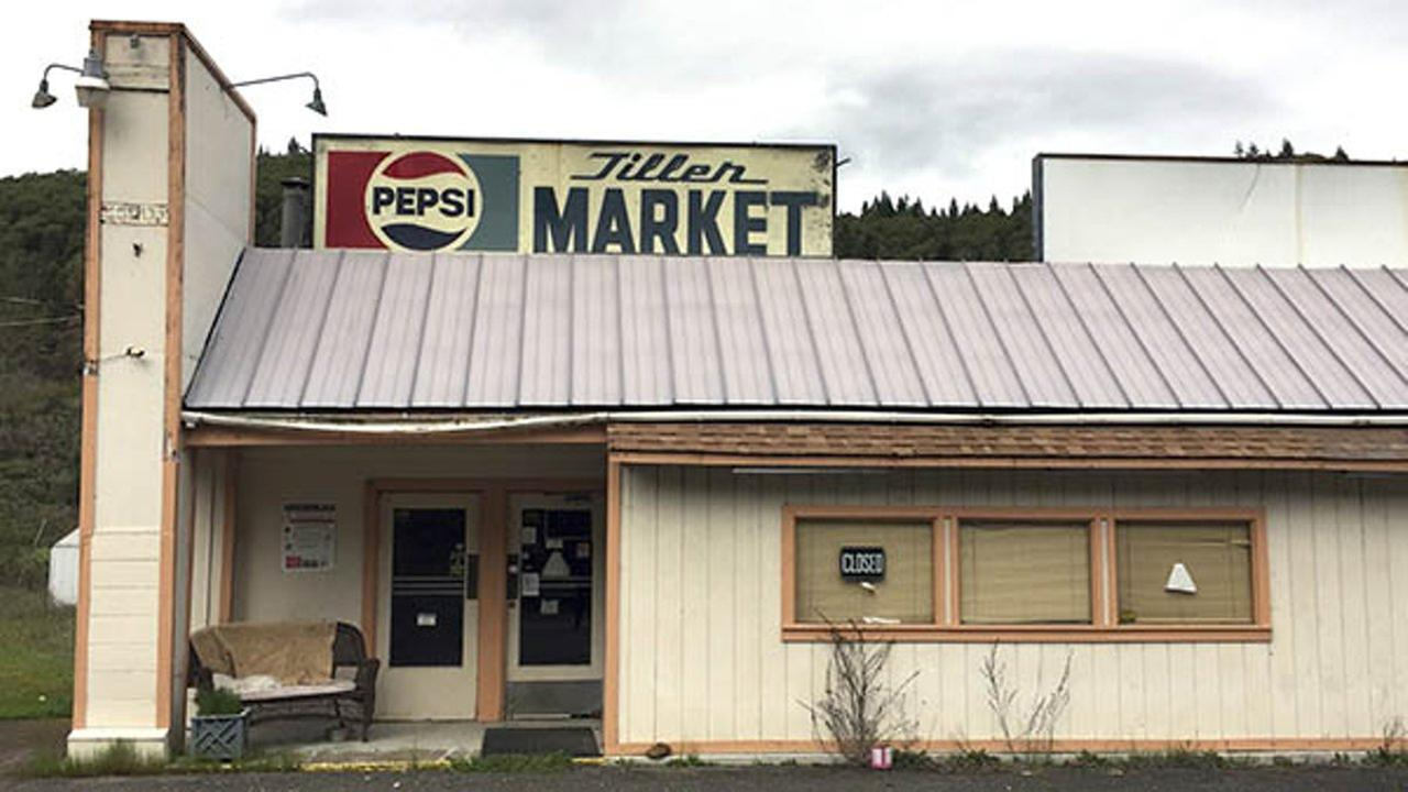 In this April 5, 2017 photo, the Tiller Market stands abandoned in downtown Tiller, Ore.