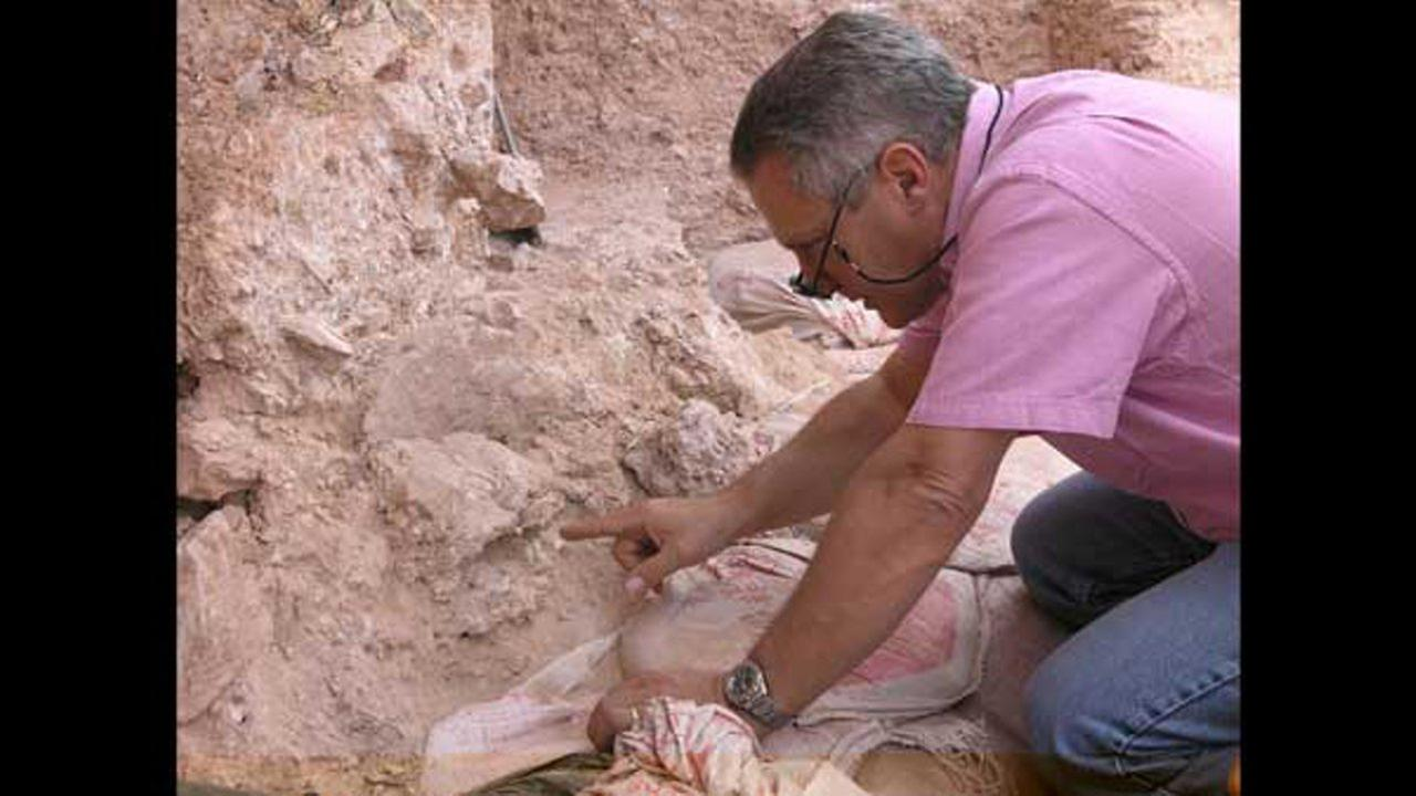 Jean-Jacques Hublin is pictured when he first saw the new finds at Jebel Irhoud in Morocco. He is pointing to the crushed human skull.Courtesy Shannon McPherron/MPI EVA Leipzig