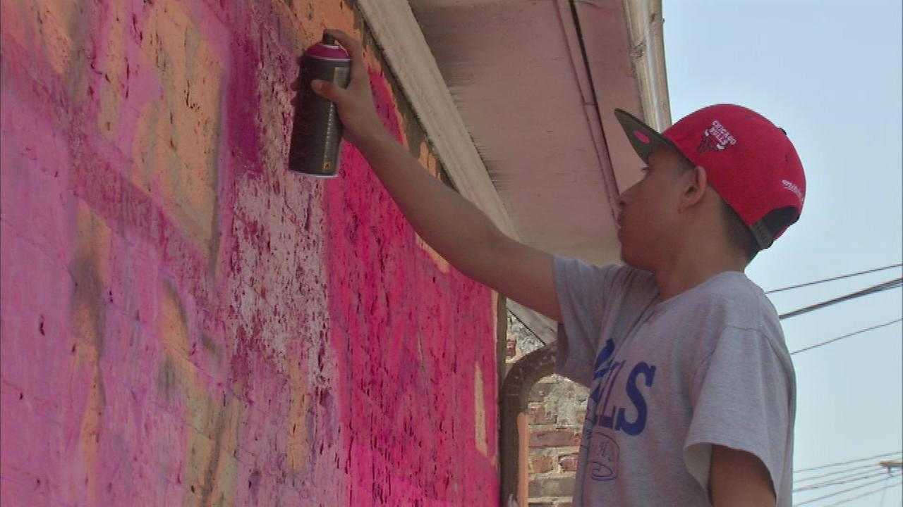 Some kids who typically get their kicks from tagging around the neighborhood are now being paid to remove graffiti and paint murals with permission.
