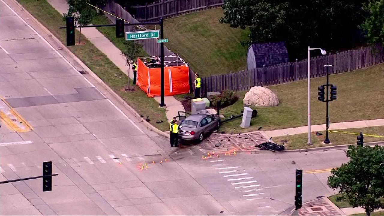 Police investigate the scene of a fatal crash in suburban Schaumburg where a car struck a motorcyclist.