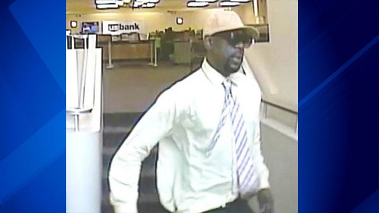 Surveillance photo of  man suspected of robbing at least three banks since June and two more U.S. Bank branches Wednesday afternoon.
