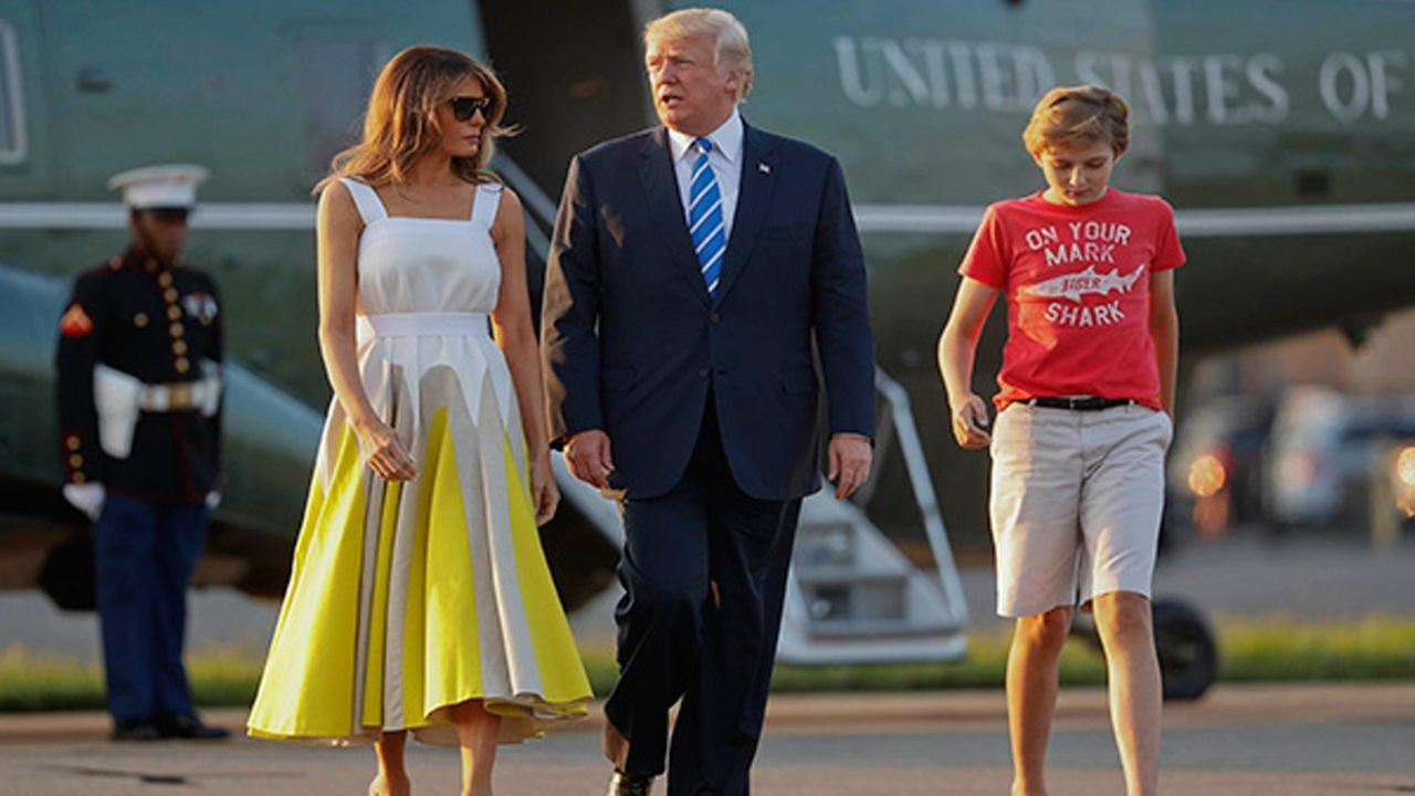 Donald Trump, Melania Trump and Barron Trump boarding Air Force One