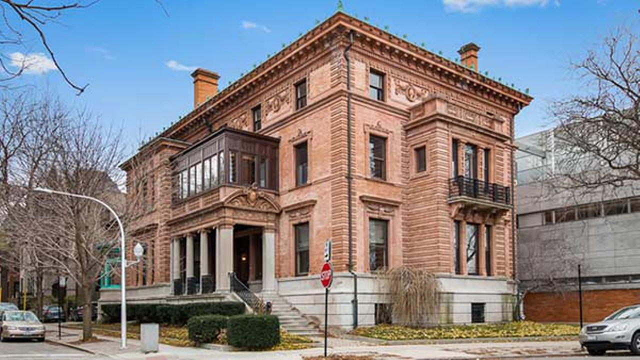 Chicagos historic Wrigley Mansion is back on the market at a lower price.