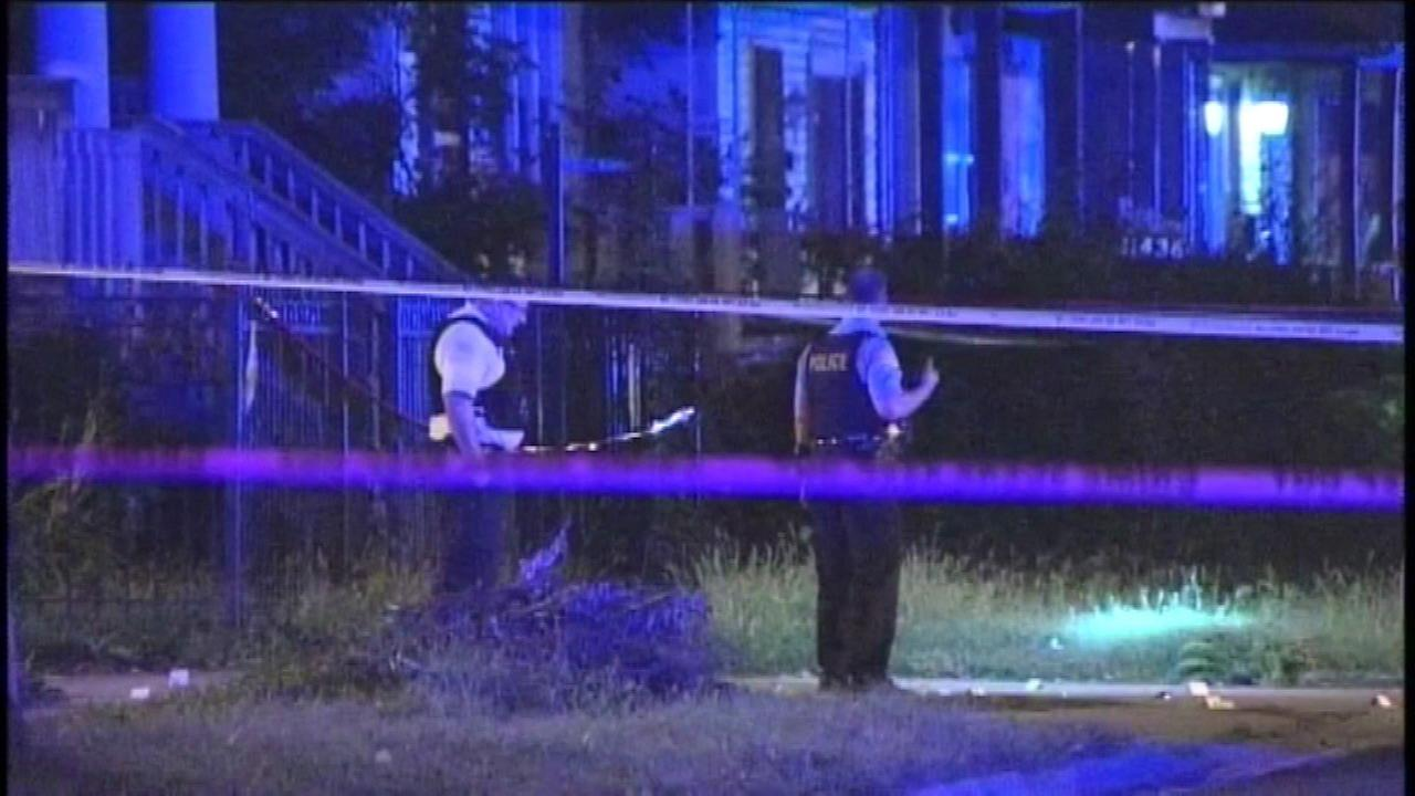 Chicago police investigate a shooting in the Roseland neighborhood that left three people dead Saturday night.