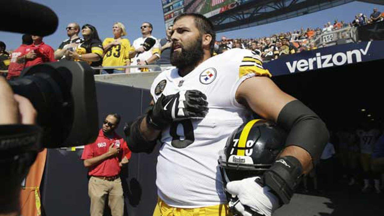 Pittsburgh Steelers offensive tackle and former Army Ranger Alejandro Villanueva (78) stands outside the tunnel alone during the national anthem before an NFL football game against the Chicago Bears, Sunday, Sept. 24, 2017, in Chicago.