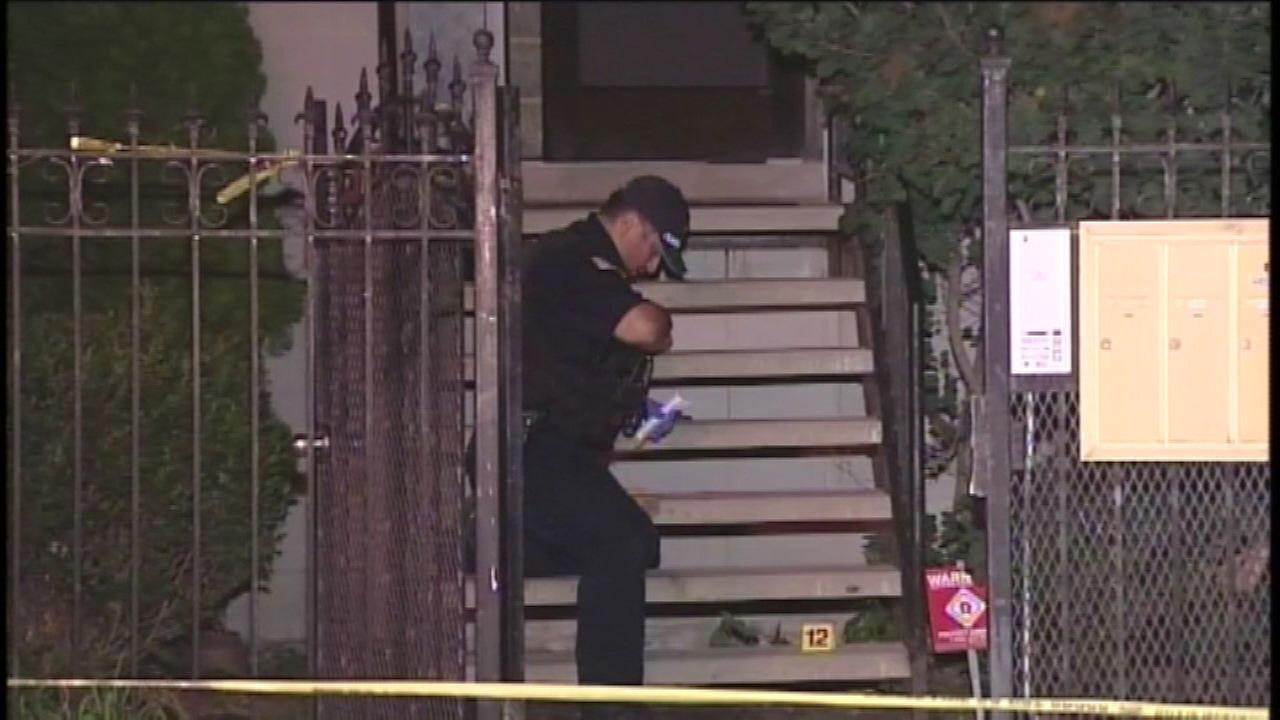 Police investigate a home invasion in the 4500-block of South St. Lawrence Avenue Saturday night.