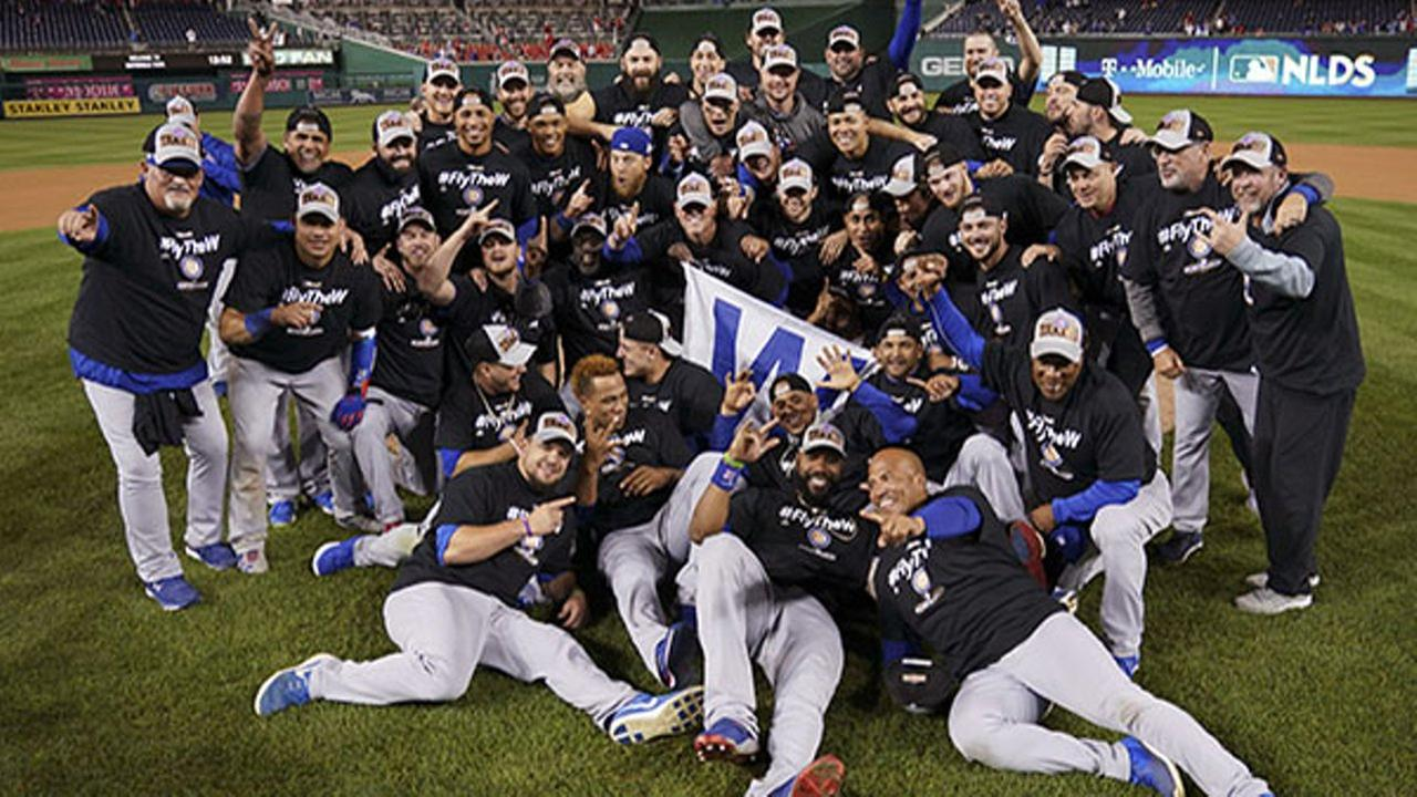 The Chicago Cubs celebrate after beating the Washington Nationals 9-8 to to win baseballs National League Division Series, at Nationals Park, early Friday, Oct. 13, 2017.