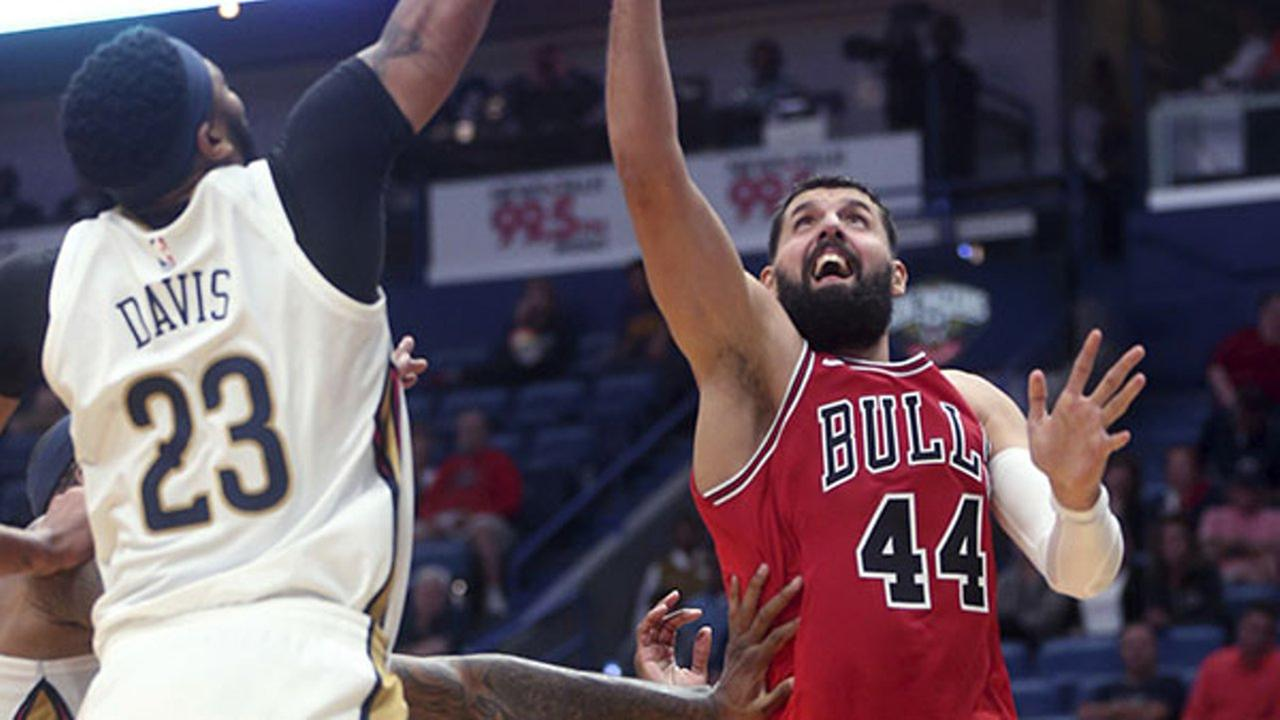 New Orleans Pelicans forward Anthony Davis (23) blocks a shot by Chicago Bulls forward Nikola Mirotic (44) in the first half of an NBA preseason basketball game in New Orleans.