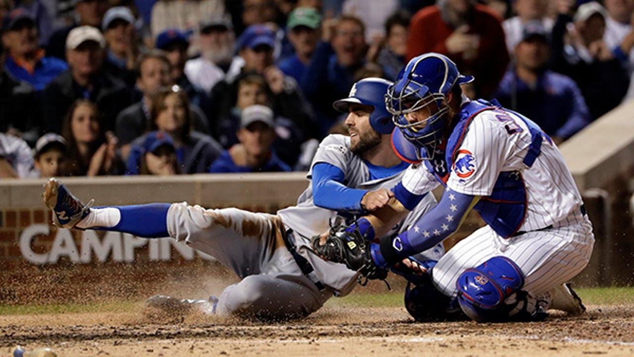 Chicago Cubs catcher Willson Contreras tags out Los Angeles Dodgers Chris Taylor during the fifth inning of Game 3 of the NLCS, Tuesday, Oct. 17, 2017, in Chicago.