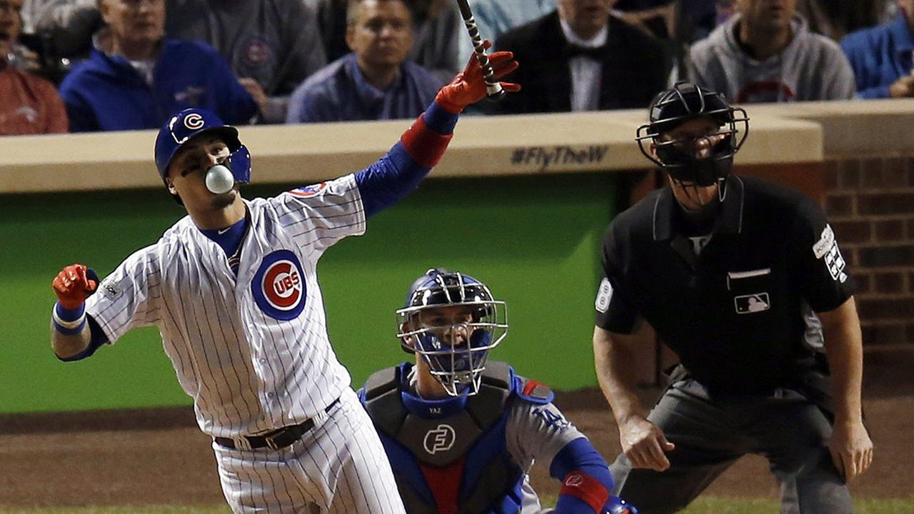 Chicago Cubs Javier Baez watches his home run during the fifth inning of Game 4 of baseballs National League Championship Series against the Los Angeles Dodgers, Wednesday, Oct. 18, 2017, in Chicago.