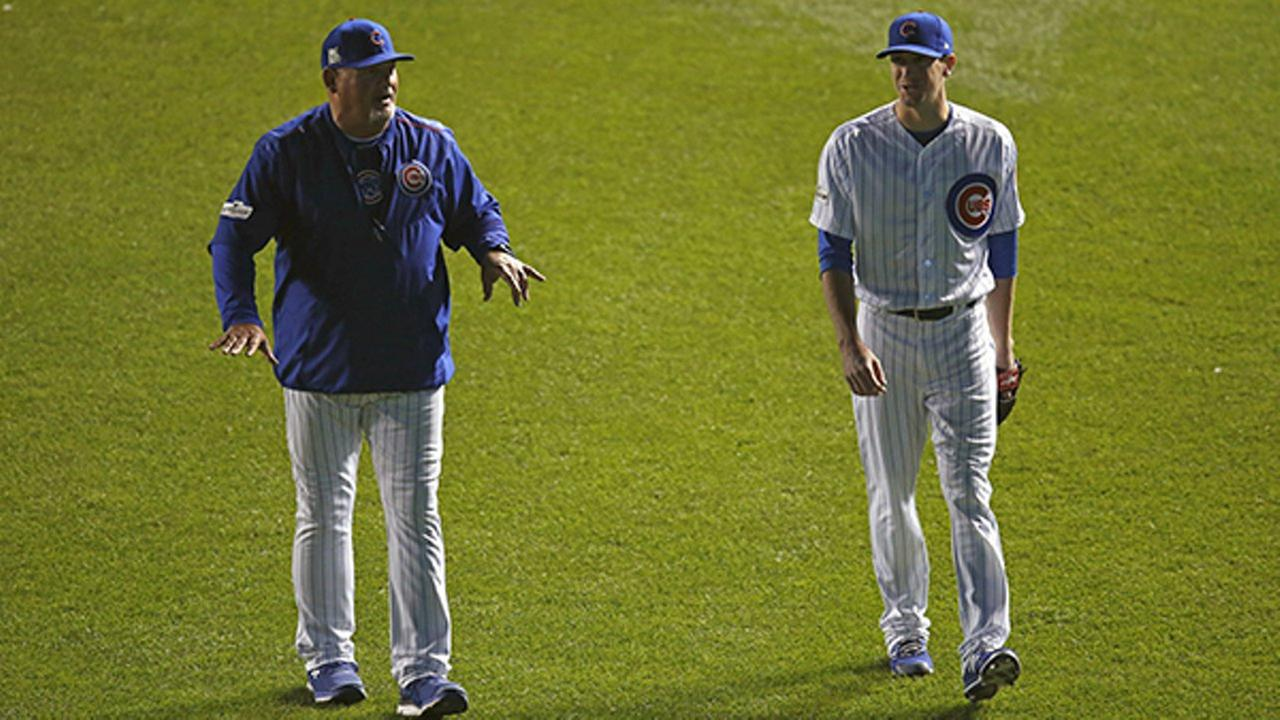 Chicago Cubs Kyle Hendricks, right, walks to bullpen to warm up with pitching coach Chris Bosio before Game 3 of baseballs NLCS against the LA Dodgers, Oct. 17, 2017, in Chicago.