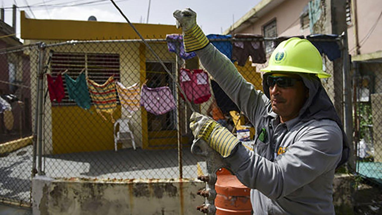 Ezequiel Rivera works with the Electric Energy Authority to restore distribution lines damaged by Hurricane Maria in the Cantera community of San Juan, Puerto Rico.