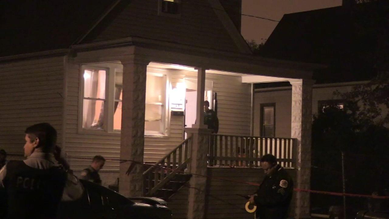 Police investigate after a woman was shot and killed at a party in the West Pullman neighborhood Saturday night.
