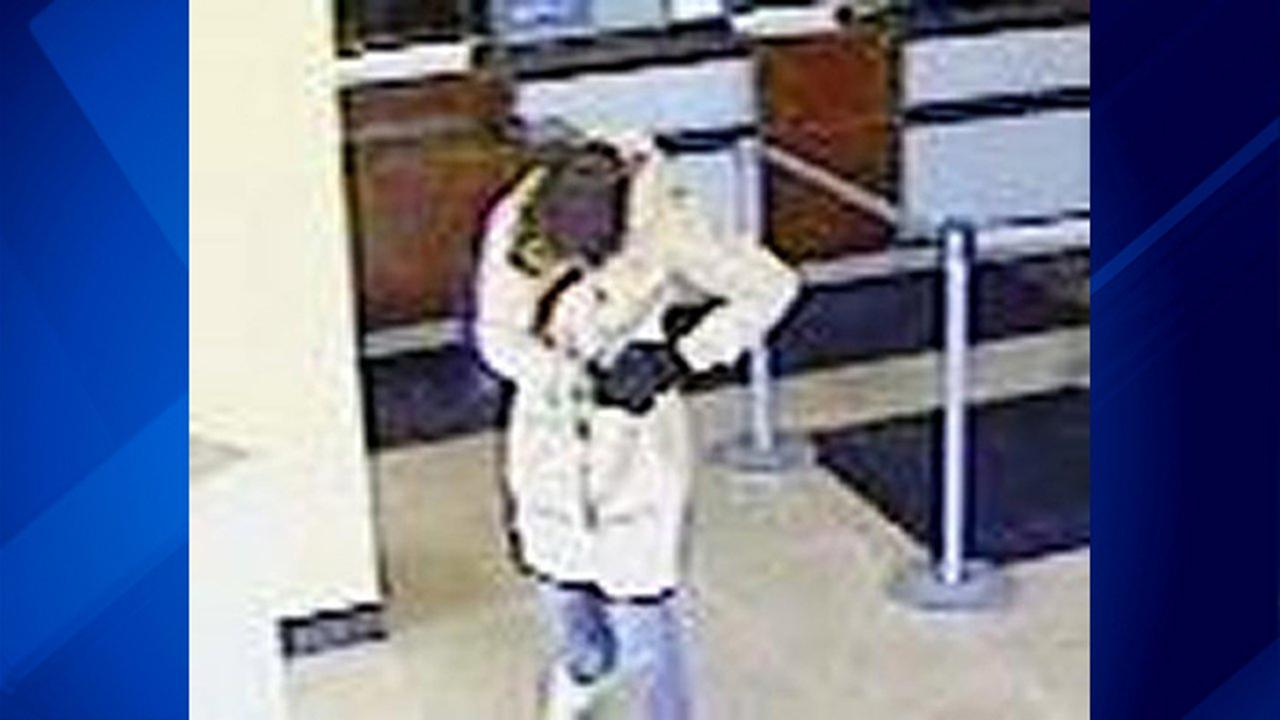 A woman wearing a nightgown and carrying a gun held up a bank Thursday morning on the border of the Uptown and Lake View neighborhoods on the North Side.