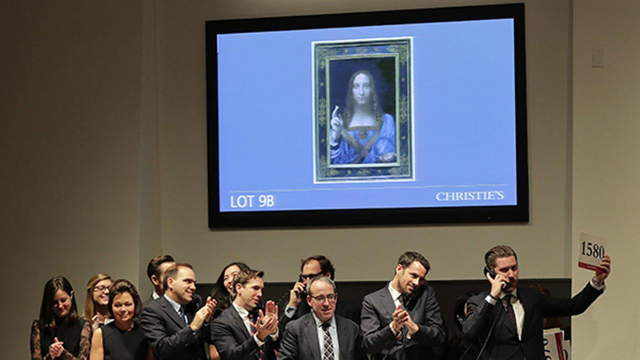 Bidding representatives react after Leonardo da Vincis Salvator Mundi sold for $400 million at Christies Wednesday Nov. 15 2017 in New York