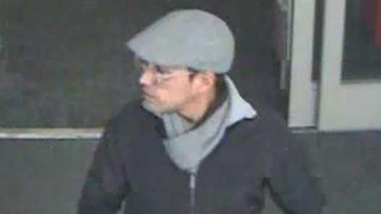 Surveillance image of a suspect who stole customers wallets on November 9 and 11 in Munster, Ind.
