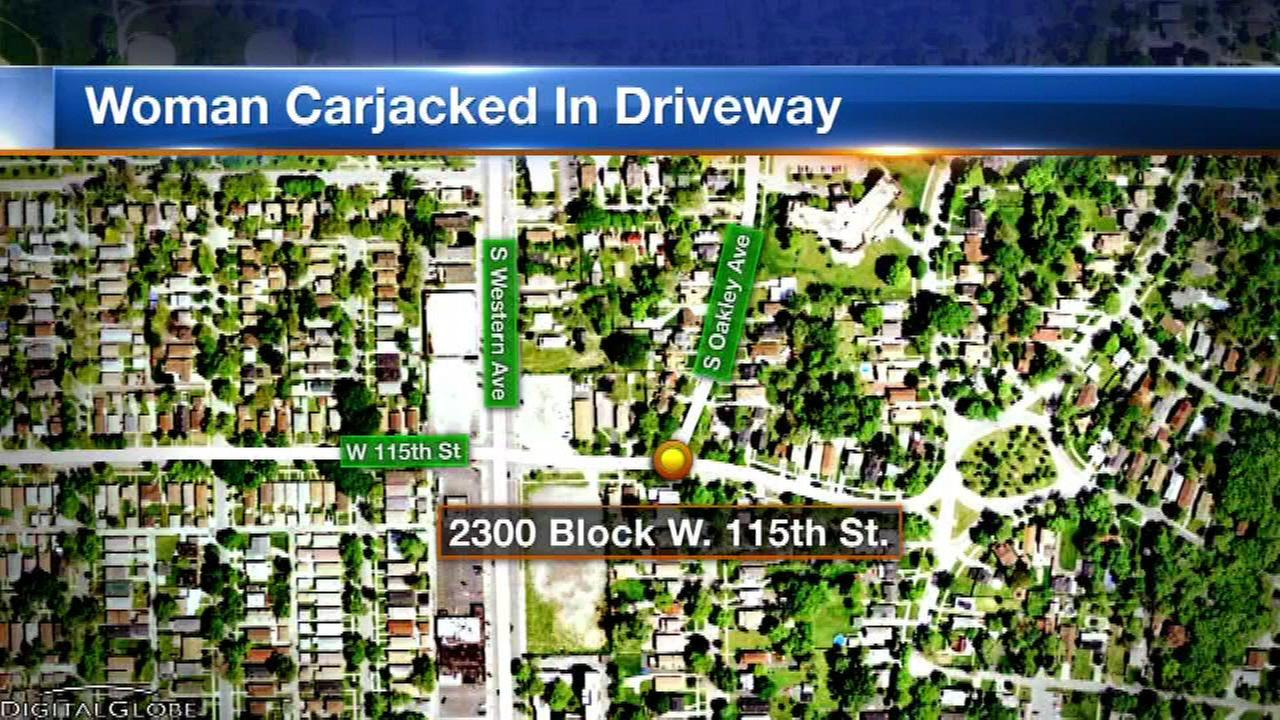 A woman was carjacked while carjacked while exiting a driveway in the Morgan Park neighborhood Sunday.