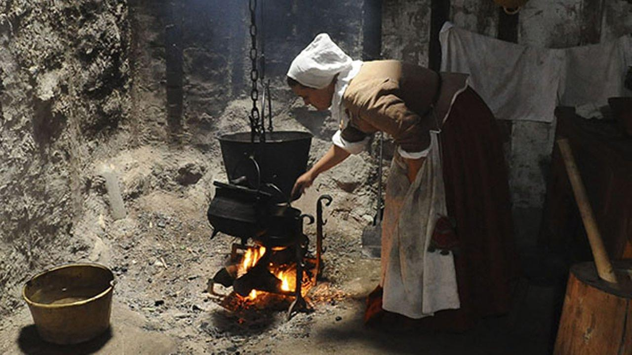 An employee of Plimoth Plantation portraying Priscilla Alden cooks hasty pudding at Plimoth Plantations 1627 English Village, Tuesday, Sept. 9, 2008 in Plymouth, Mass.