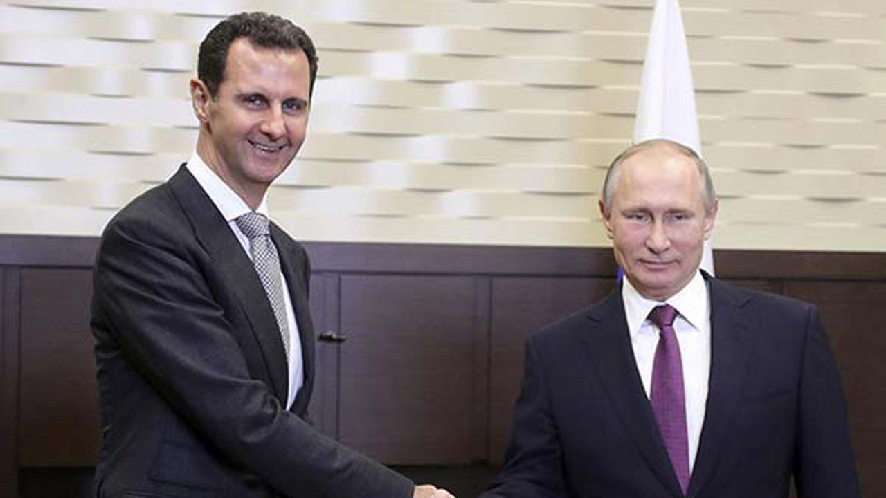 In this photo taken on Monday, Nov. 20, 2017, Russian President Vladimir Putin, right, shakes hand with Syrian President Bashar Assad in Russia.
