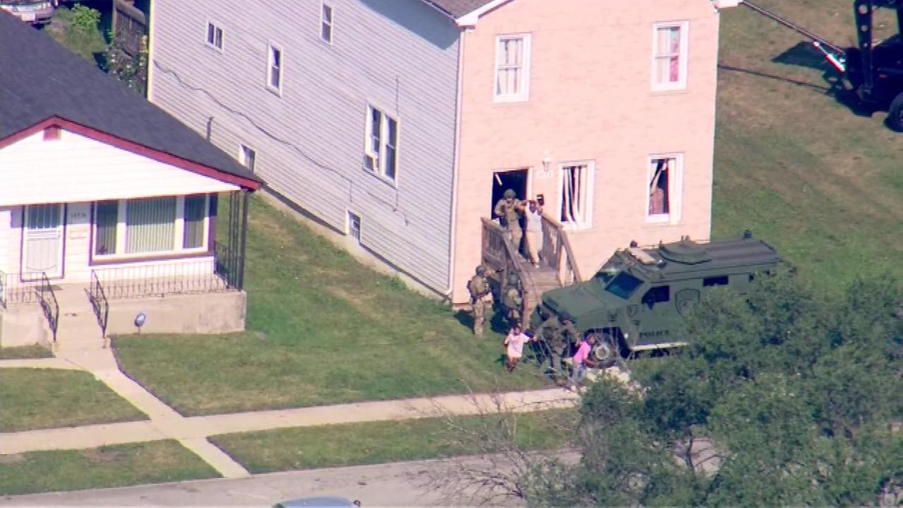 Around 9:15 a.m. Wednesday, two children were escorted out of the home. They were followed by two female adults, the last of the hostages to be released.