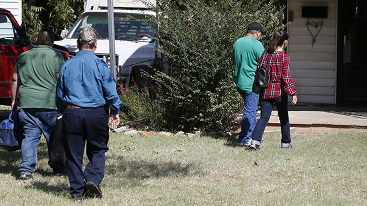 People arrive at the home of Magdiel Sanchez, the site of an officer involved shooting, in Oklahoma City, Wednesday, Sept. 20, 2017.