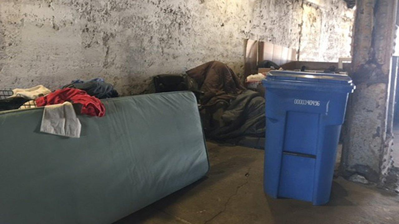 Tommy Miller discusses the effect of weekly cleanups on his home under the viaduct.