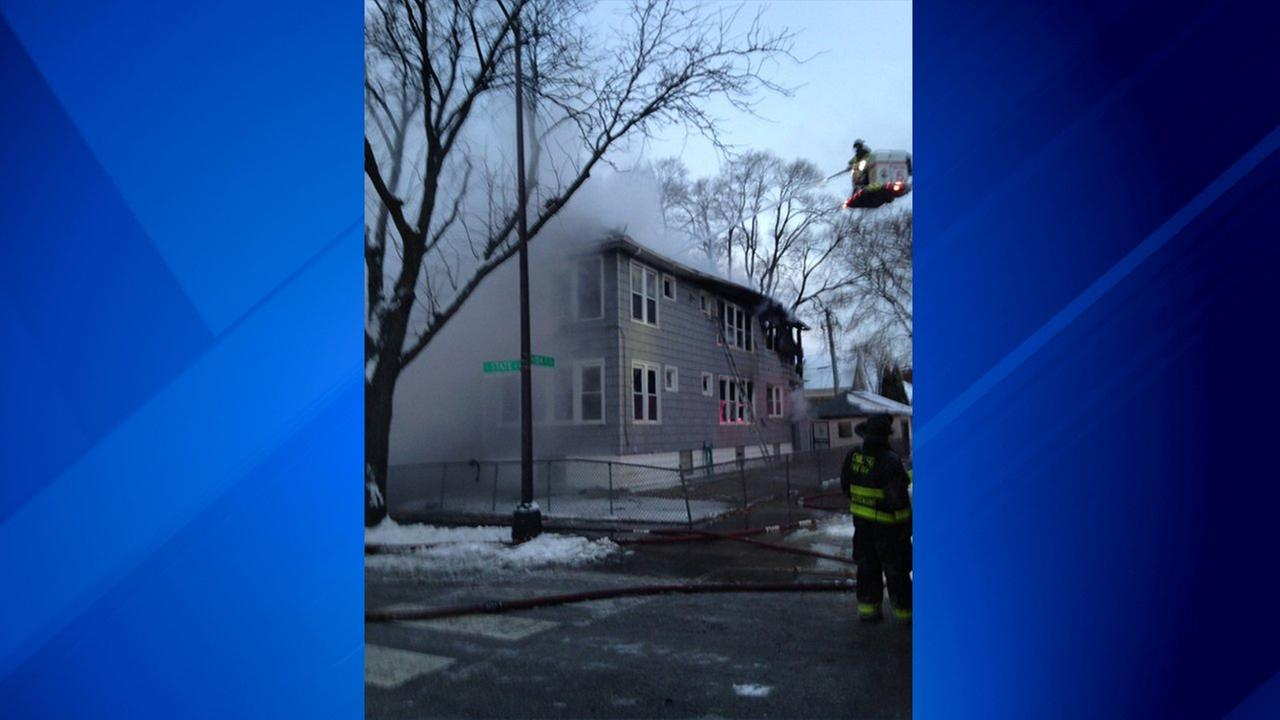 Firefighters battle a blaze in a two-story home near 104th and State Streets Monday morning.
