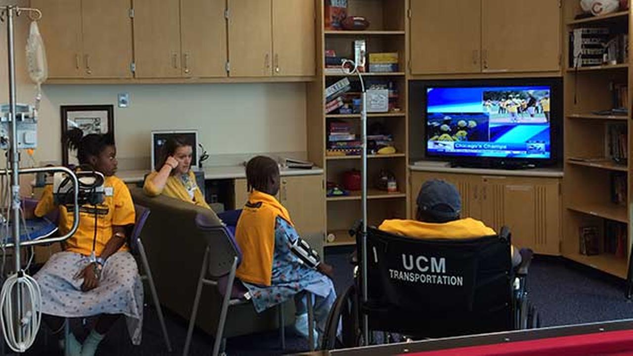 Patients at Comer Childrens Hospital watch JRW Parade on TV