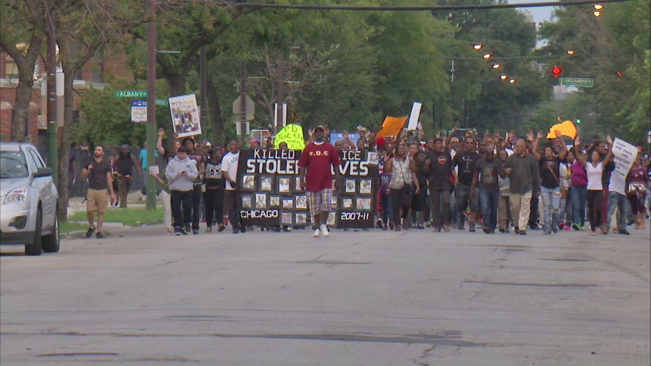 Hundreds of people protested at the 11th Police District on Wednesday night over a deadly police shooting Sunday and others in the past in Chicago.