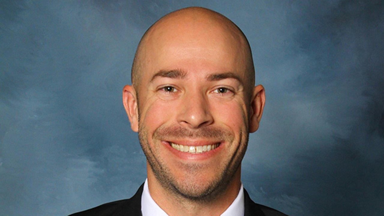 This photo provided by the University of Dubuque shows assistant womens basketball coach Justin Smith.