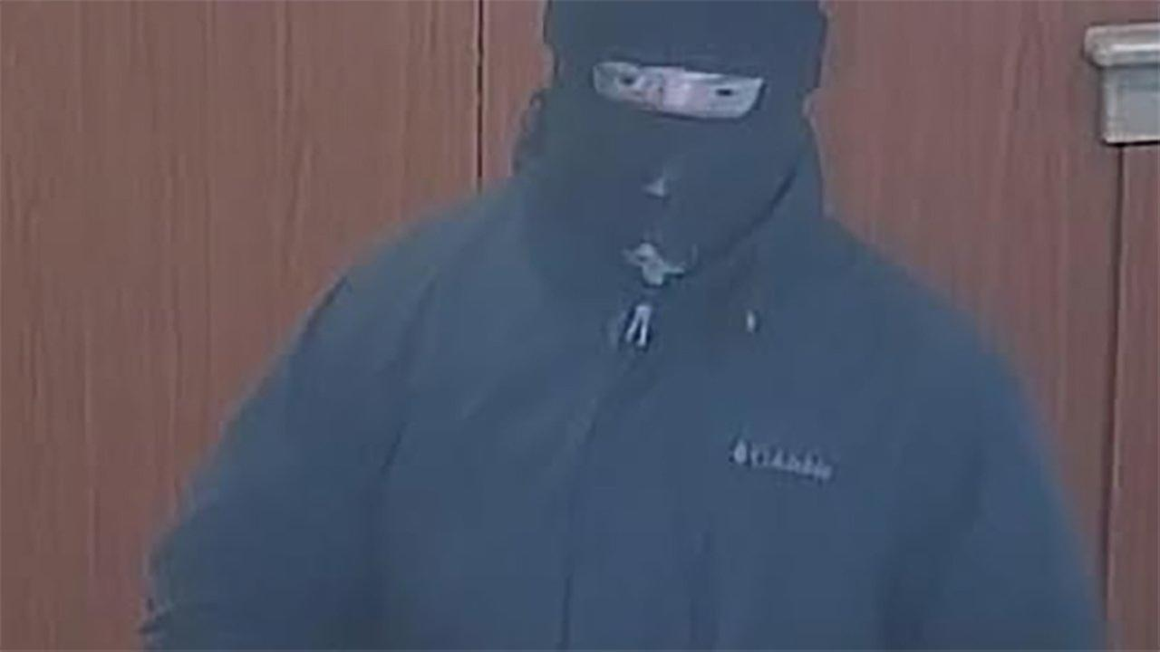 A surveillance photo of a person who robbed a bank Saturday in Lake Forest.