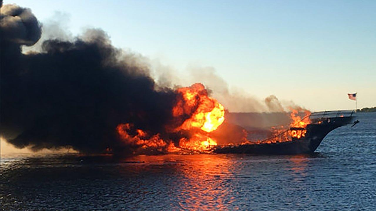 In this photo provided by Pasco County flames engulf a boat Sunday, Jan. 14, 2018, in the Tampa Bay area.