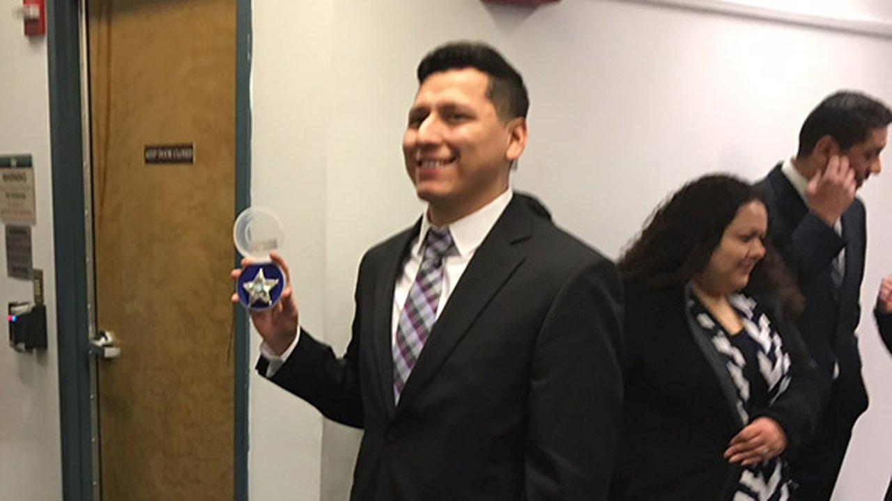 The brother of a 6-year-old boy shot and killed more than 20 years ago was sworn in Monday as a police officer in southwest suburban Aurora.Aurora Police Department
