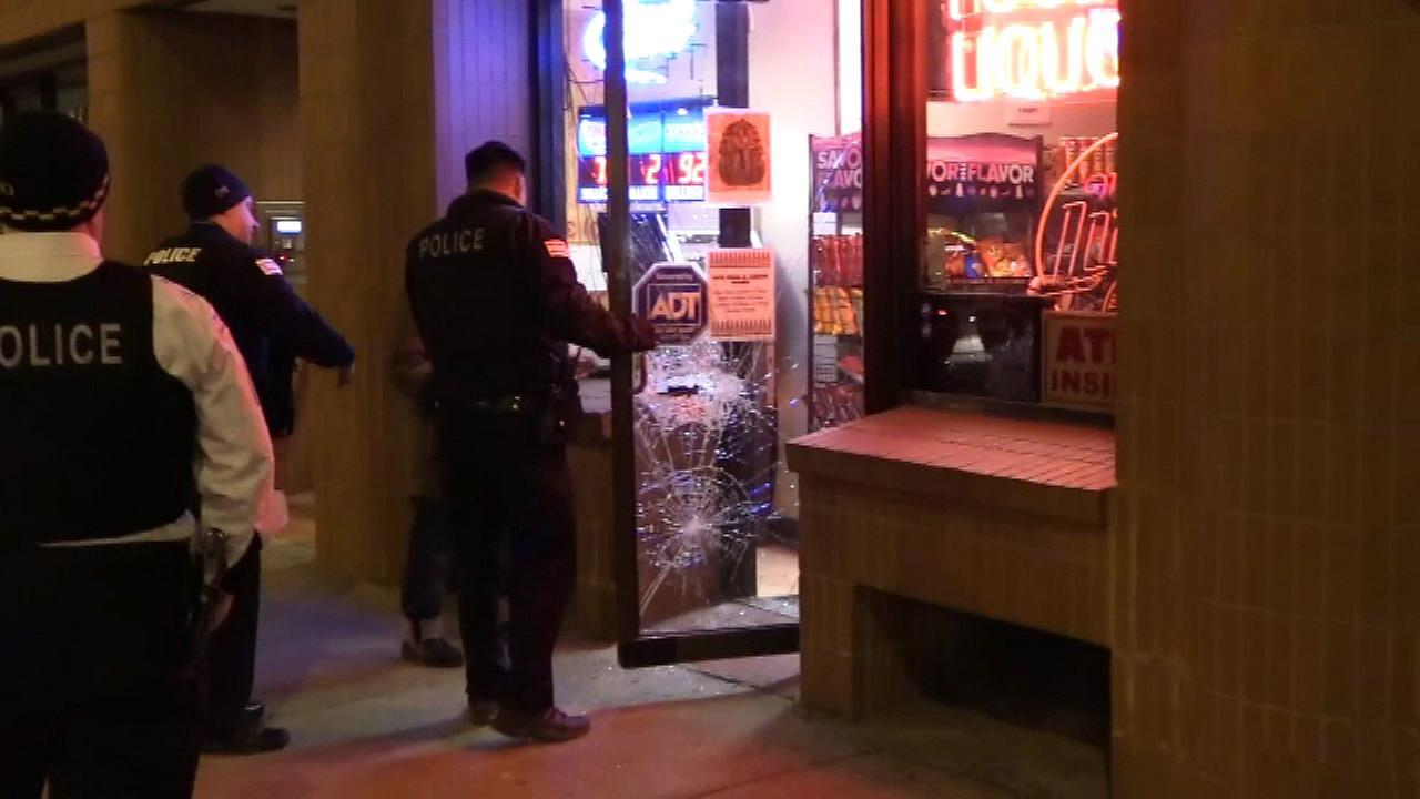 Police investigate a break-in at a River North convenience store Wednesday morning.