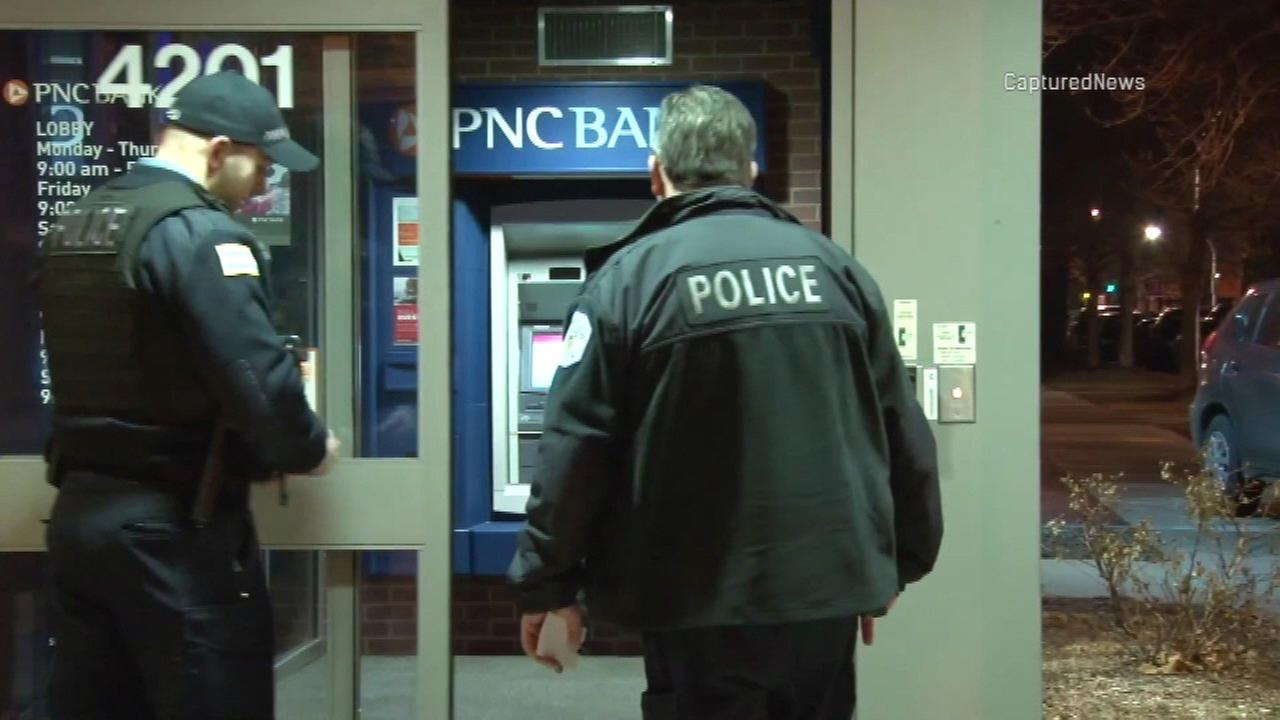 Police investigate a skimming device found on an ATM at a North Side PNC Bank branch.
