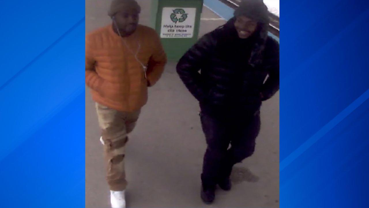 Surveillance image of two suspects wanted in connection with the robbery of a man in a wheelchair on a Blue Line train last month.