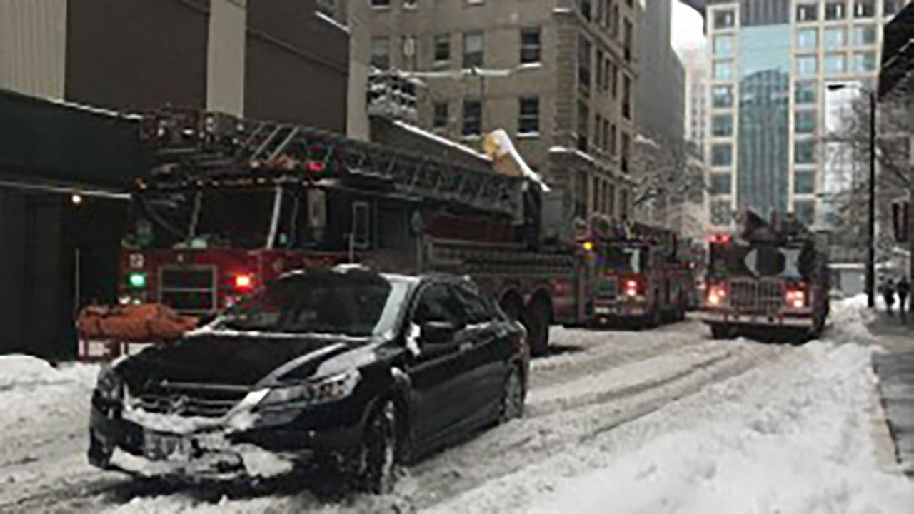 Car catches fire at John Hancock Center parking garage