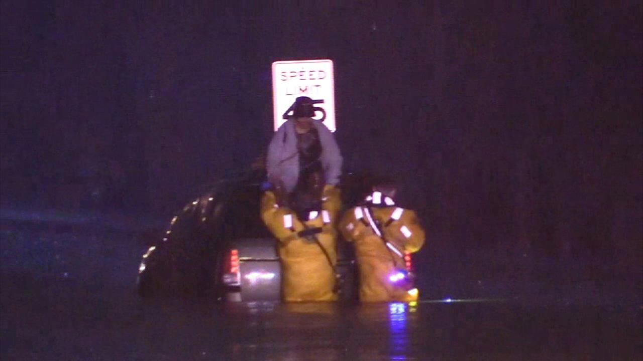 A woman is rescued from a flooded car in Dolton.