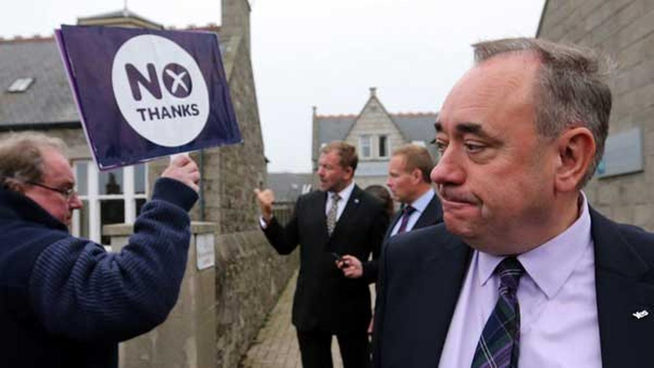 Scotlands First Minister Alex Salmond, looks on at a No campaigner during a walkabout in Ellon, Scotland.