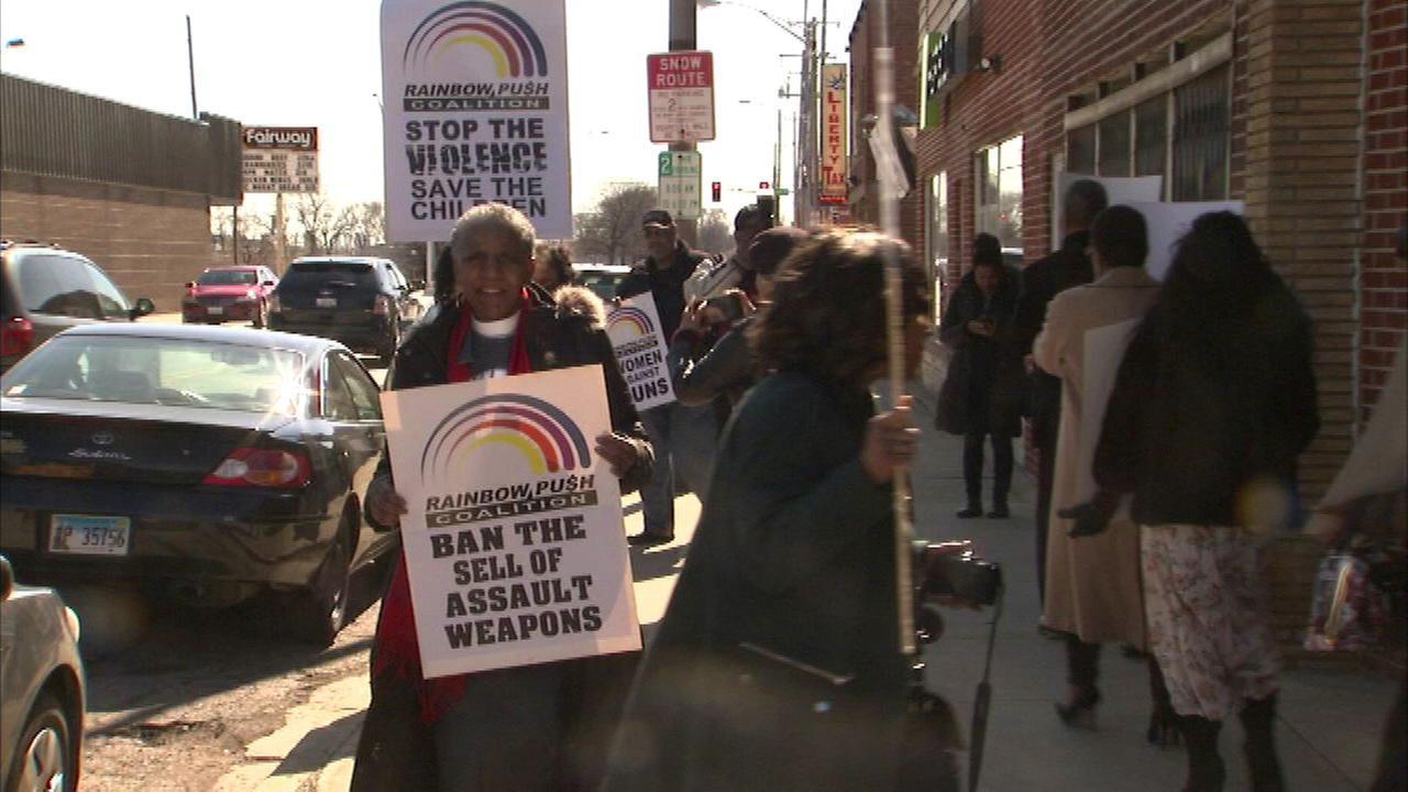 Demonstrators outside Chucks Gun Shop in Riverdale.