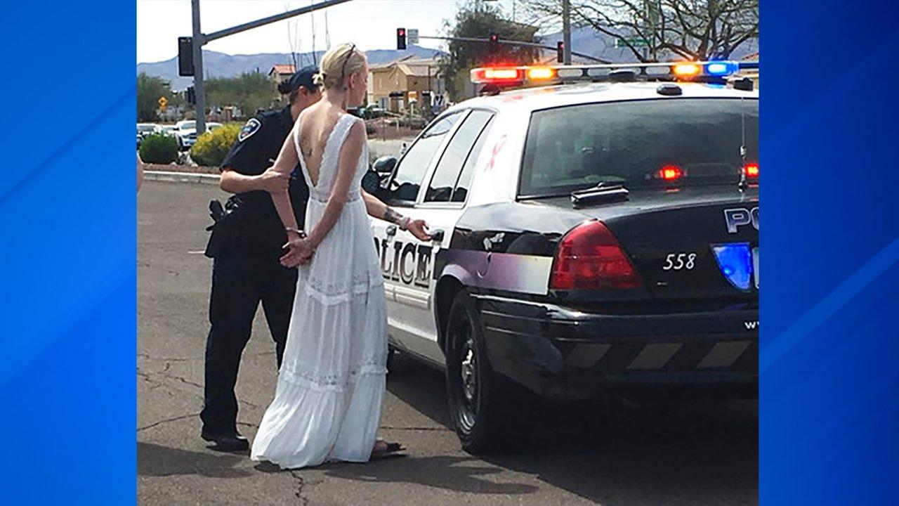 This photo provided by the Marana Police Department, in Arizona, shows 32-year-old Amber Young during her arrest on suspicion of impaired driving March 12, 2018, in Arizona.